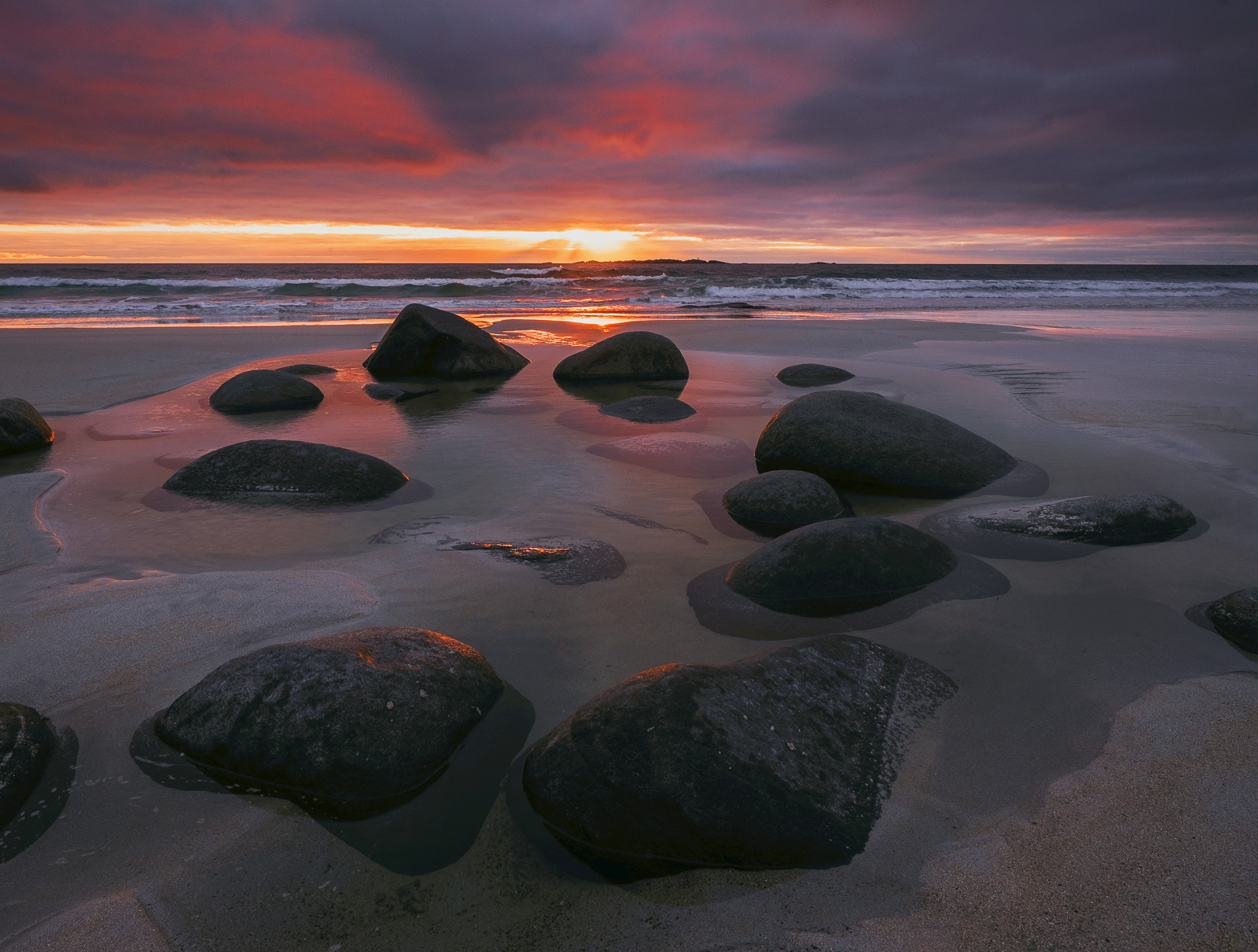 Uttakliev beach is laden with large rounded boulders embedded in the sand. The extreme weather and huge tides batter this...