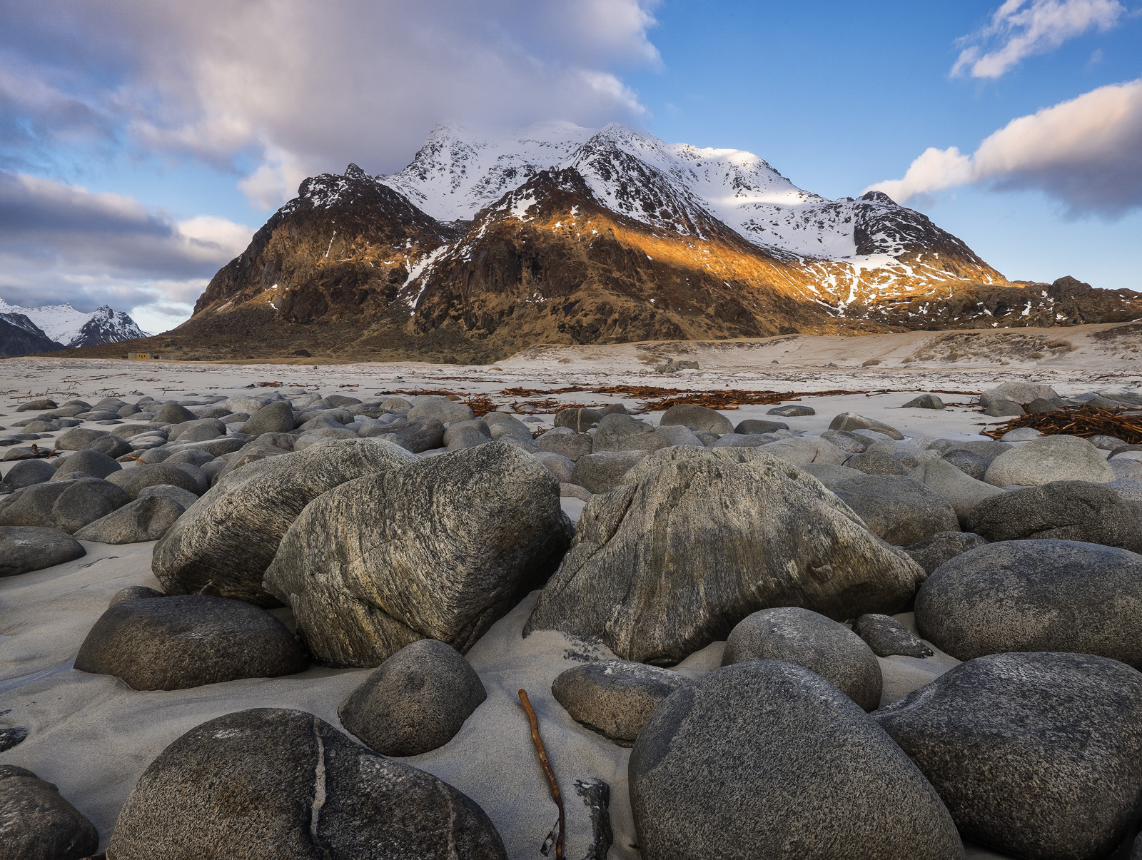 One of the most popular beaches on the Lofoten Islands Uttakliev has some remarkable boulders embedded in the soft sand and the...