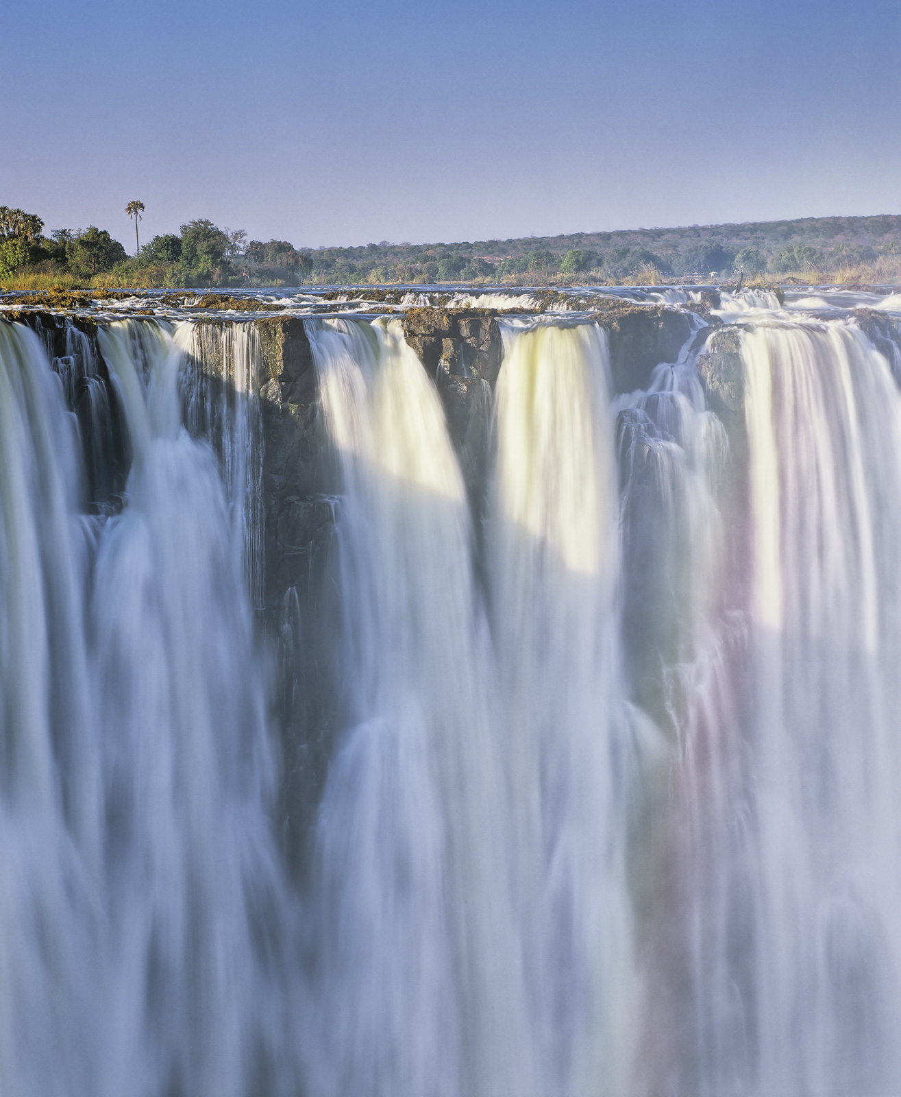 One of the Seven Wonders of the World the mighty Zambesi river plunges over a chasm a mile wide and 111 metres deep to form the...