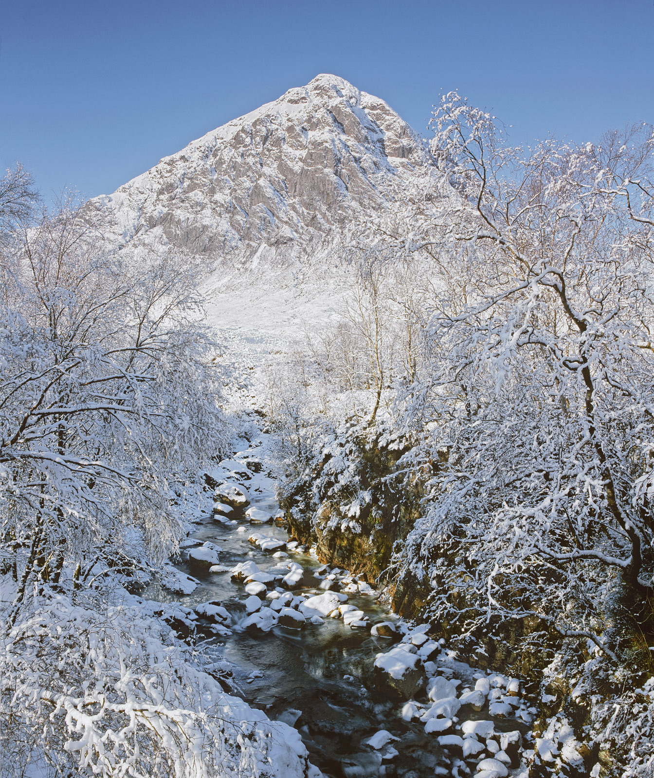 The white pyramid of a snow blasted Buachaille etive mor straddles the rubble strewn river Coupal but for a change every rock...