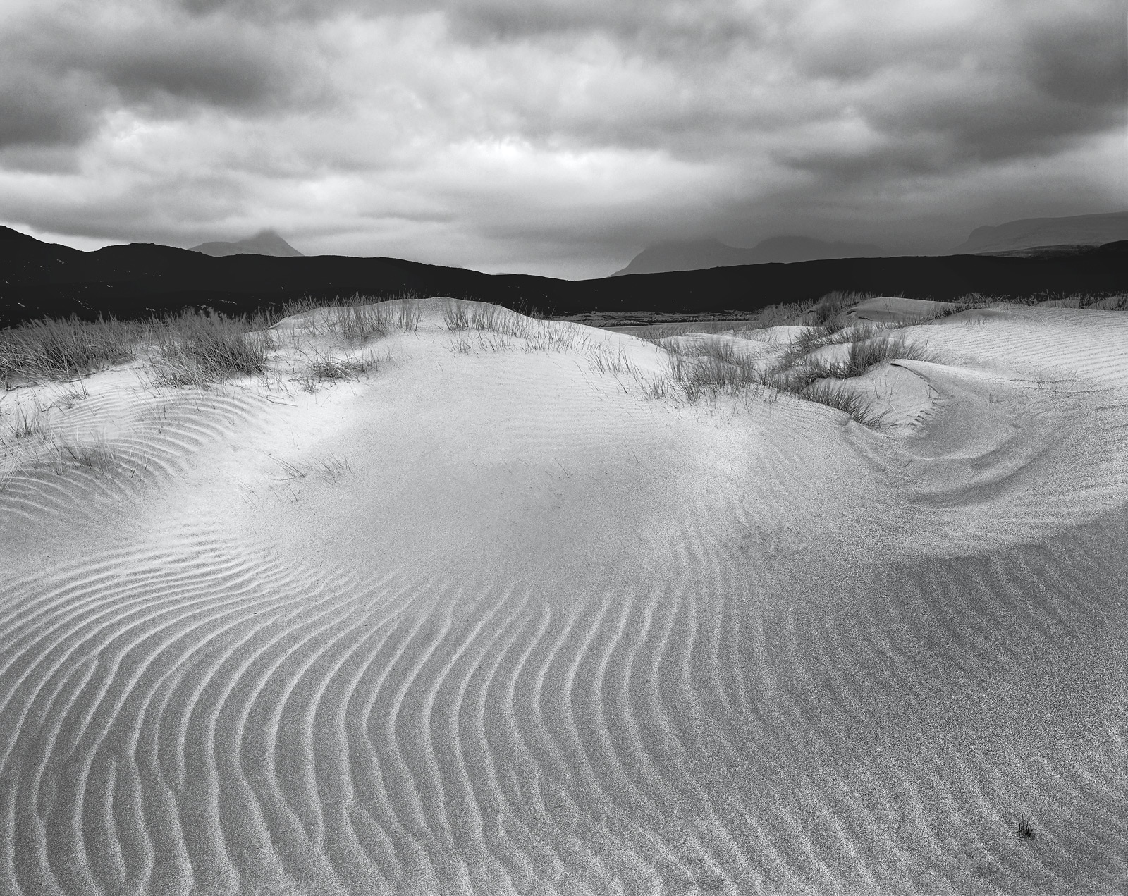 I visited the beach at Achnahaird Bay on a day of extremely high winds. The same wind had grabbed the sand off the beach...