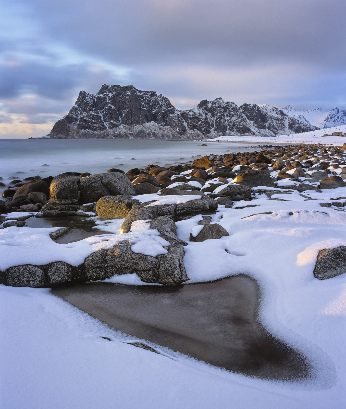 Lofoten has a few remarkable beaches and Uttakliev is most definitely one of these. Wave sculpted rocks and black boulders...