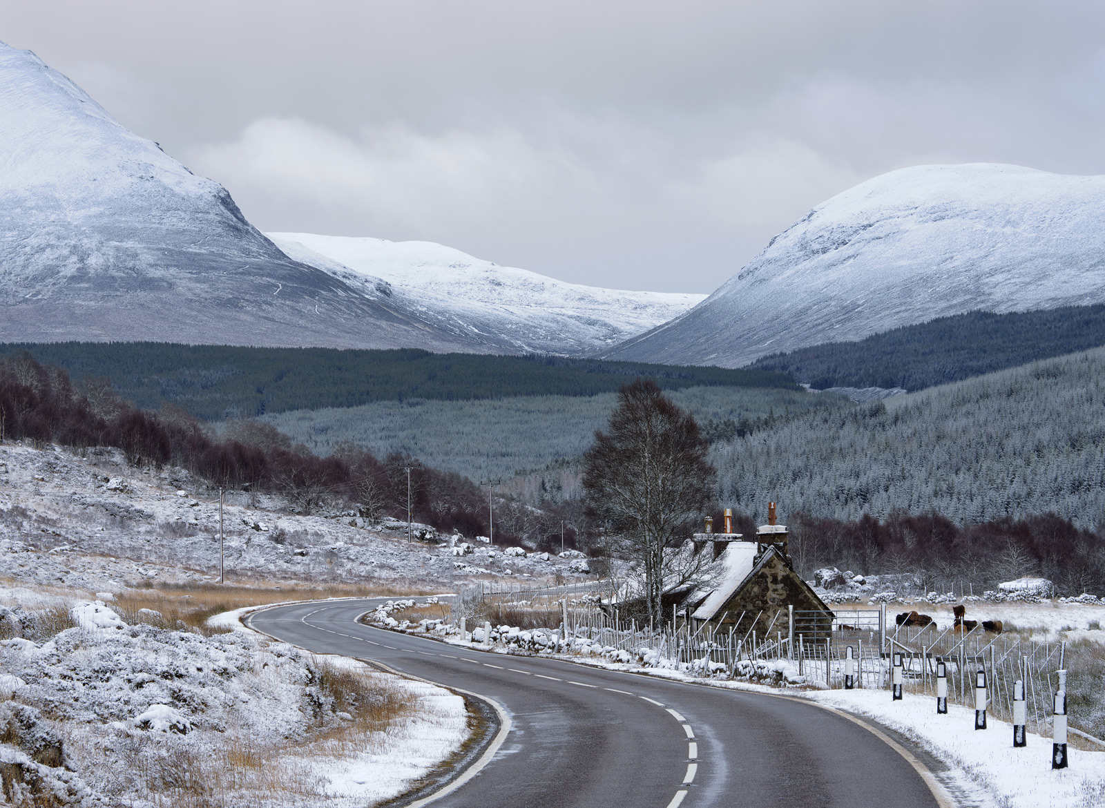 The road weaves itself through the snow clad tops of Ben Wyvis passing by Lubfearn house on its way to Glascarnoch and thence...