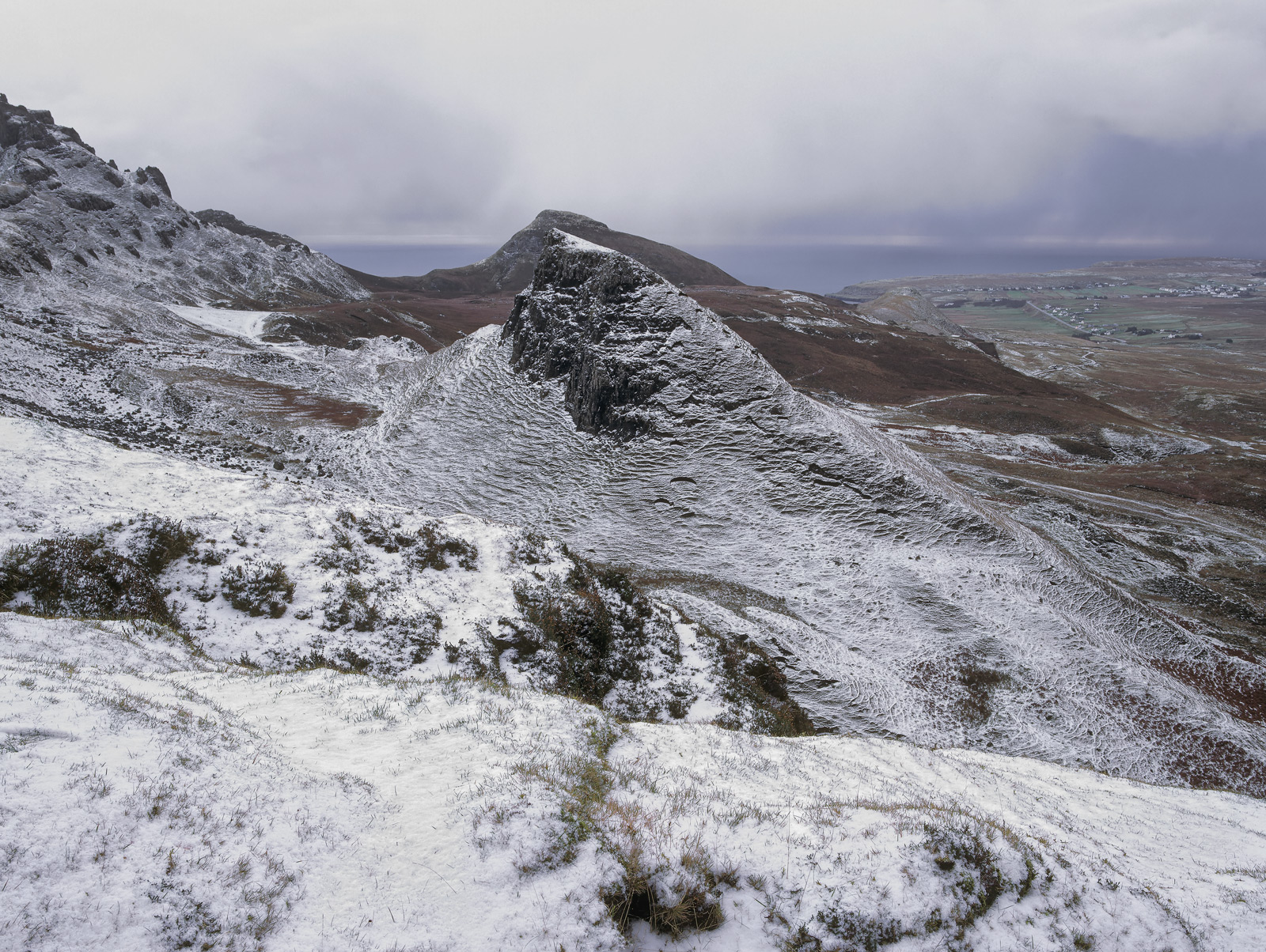 A winter dusting of snow on the Trotternish ridge at the northern end of Skye reveals the contour ridges on the slopes that have...