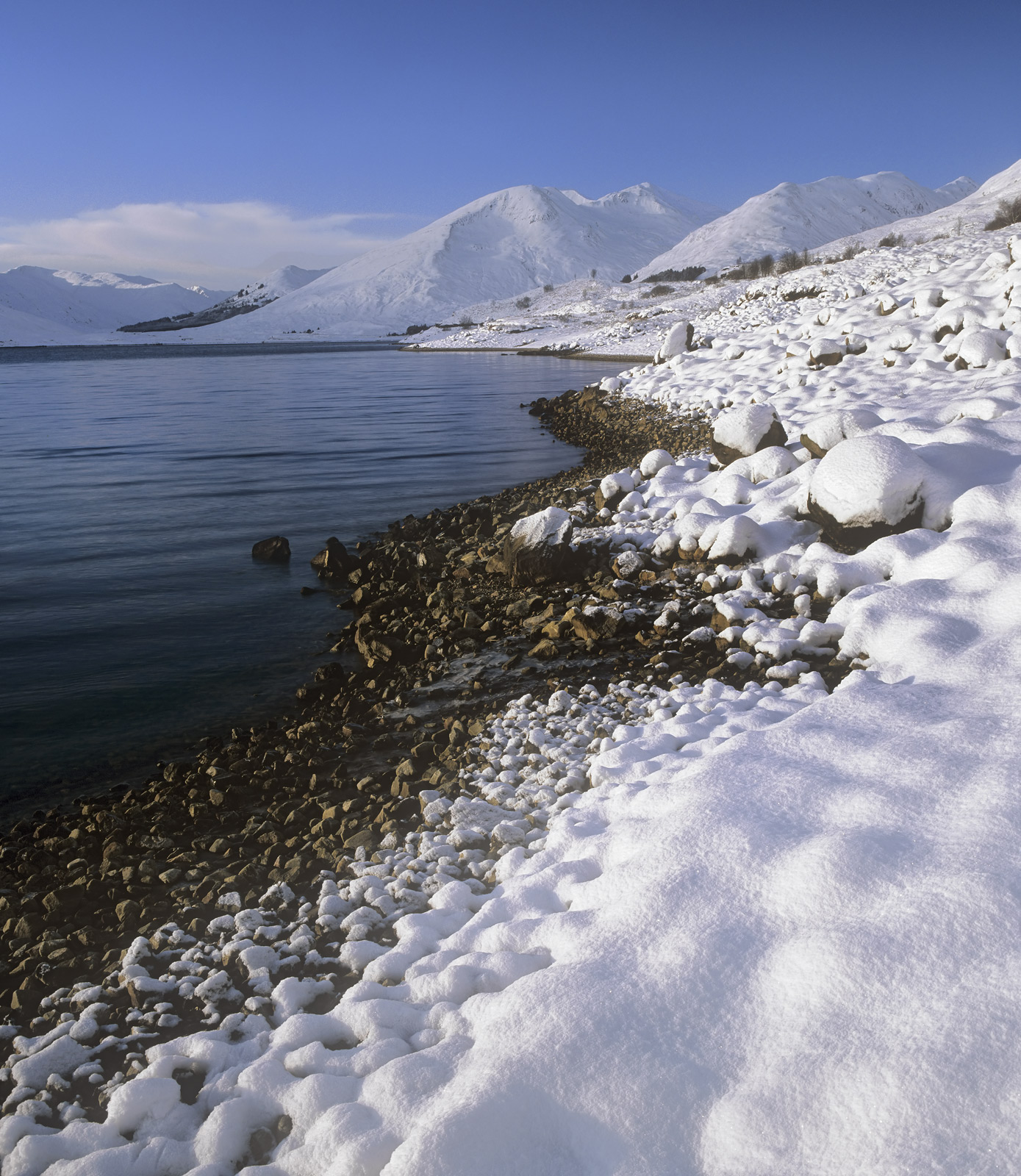 A huge dump of snow deposits itself over Glen Shiel the surrounding mountains and the dammed Loch Cluanie. The changing...