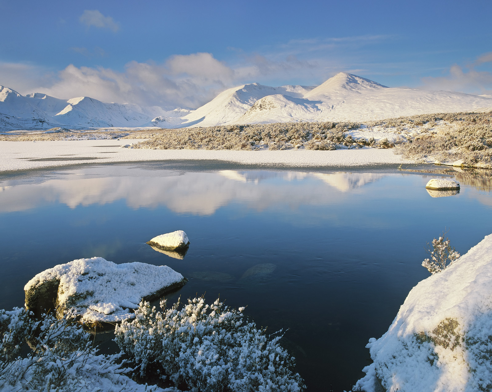 On a pristine winter morning snow lies thickly across every square inch of Rannoch moor and its complex network of lochans....