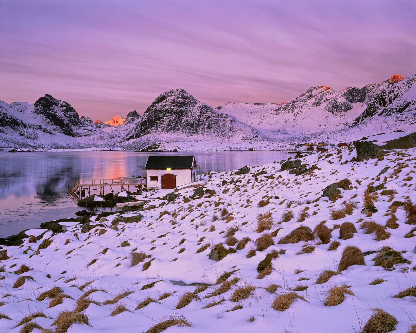 I find this an irresistable location with a charming little rorbrua by the waters edge and a magnificent backdrop of snow covered...