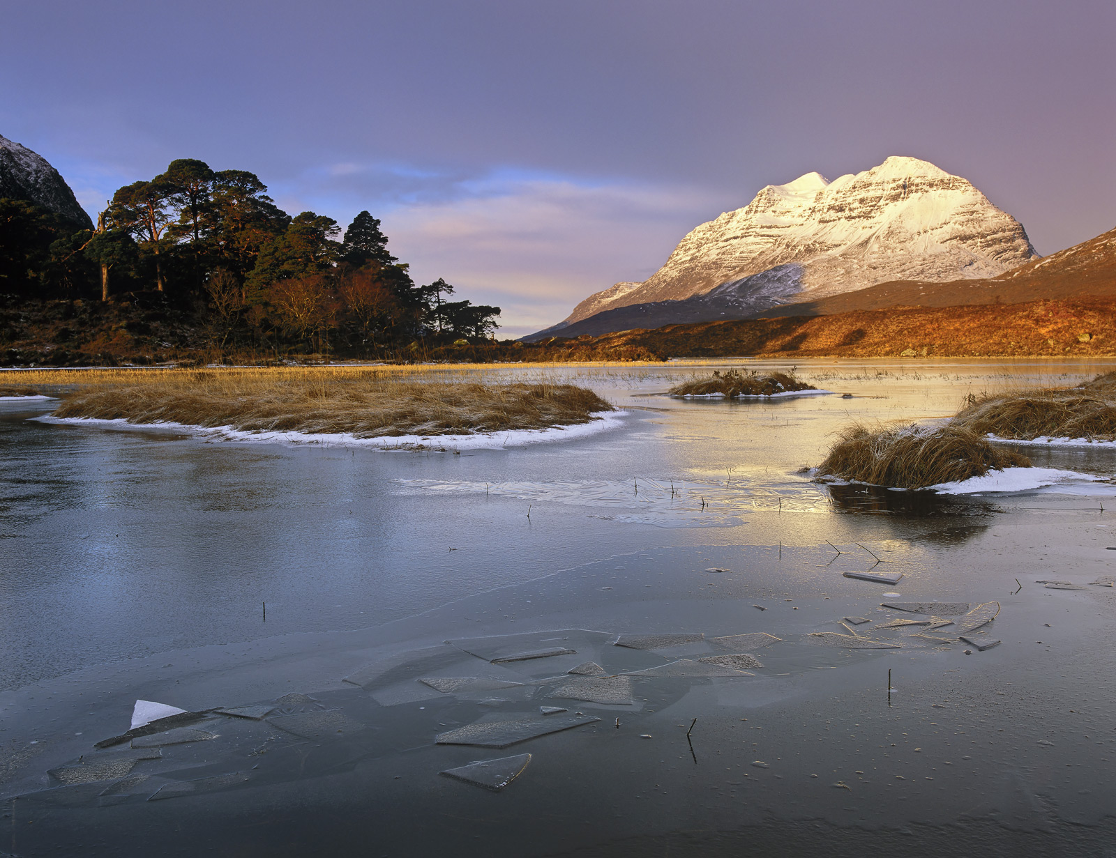 One of the most beautiful and heartwarming winter sunrises I can remember at the edge of Loch Clair with fractured patterns of...