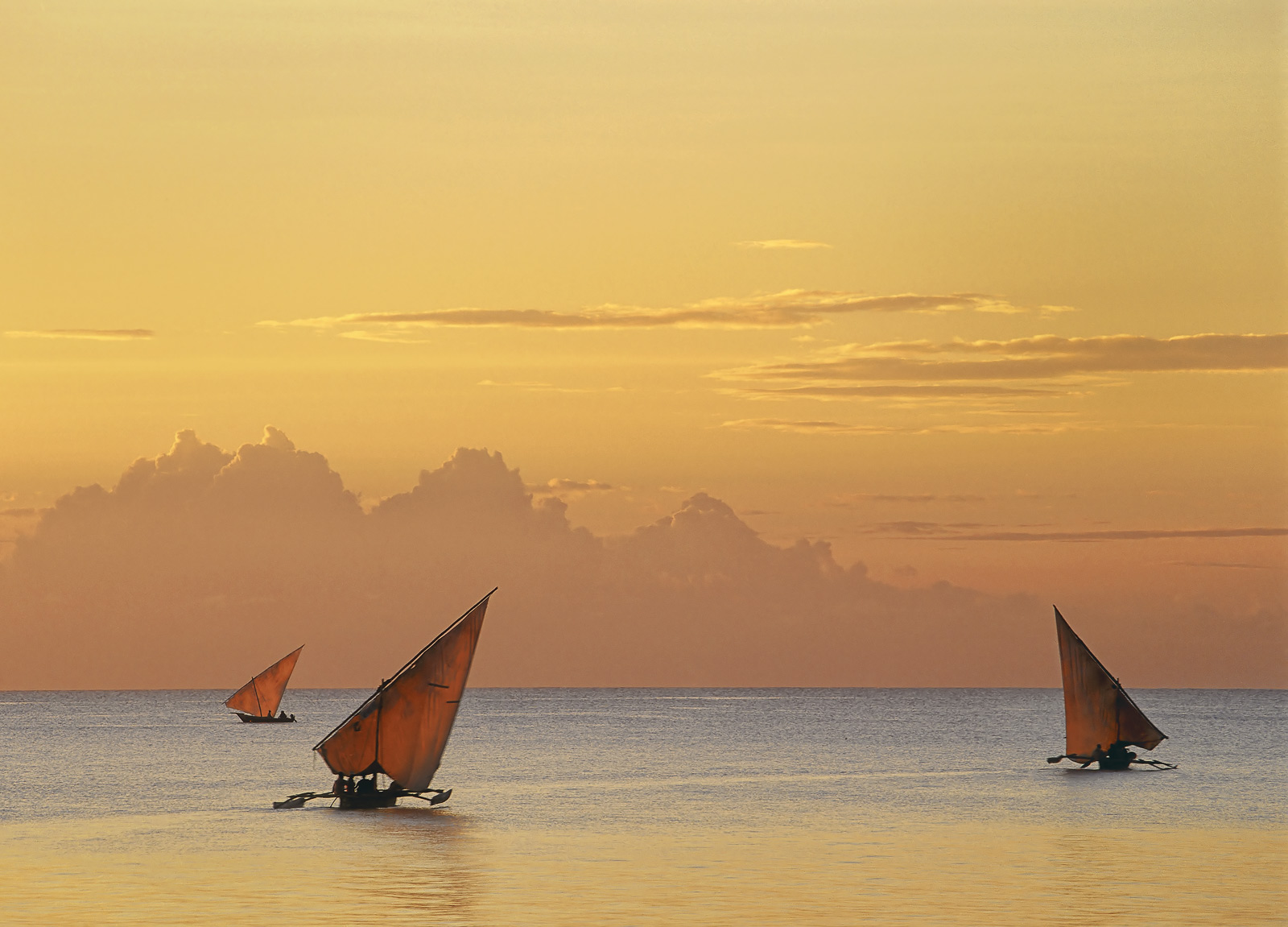 With exquisite soft yet golden post sunset light backlighting the translucent triangles of sail cloth and the drifting serenity...